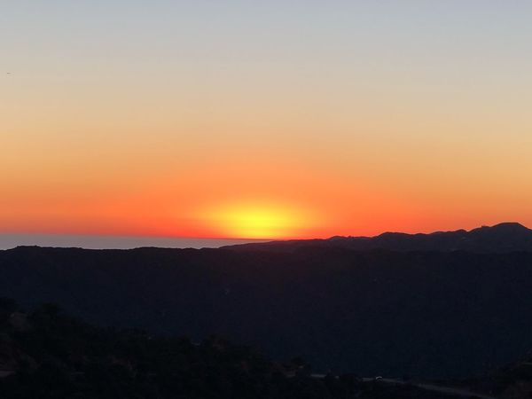 Sky Sunset Scenics - Nature Beauty In Nature Orange Color Tranquil Scene Tranquility Mountain Mountain Range Outdoors Romantic Sky Landscape Nature Environment Dramatic Sky No People Silhouette Non-urban Scene Idyllic