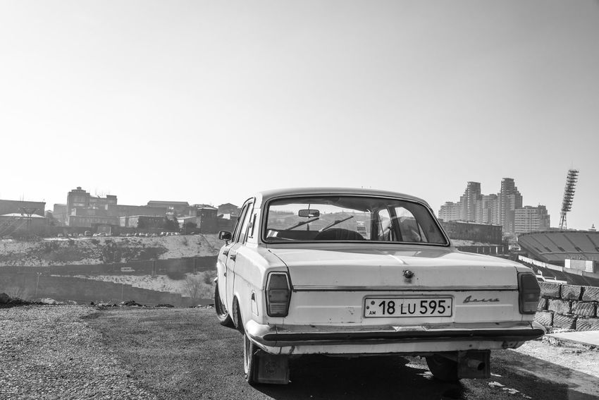 Architecture B&w Black And White Car City Cityscape Clear Sky Communism Day LADA Mode Of Transport No People Nostalgia Old Car Old School Ostalgie Outdoors Russian Car Sky Street Photography Transportation Urban