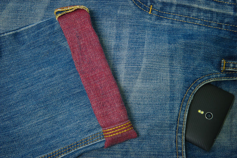 mobile phone in jeans pocket Backgrounds Black Color Blue Close-up Day Design Detail Fabric Full Frame Man Made Object Multi Colored Pair Part Of Red Still Life Textile