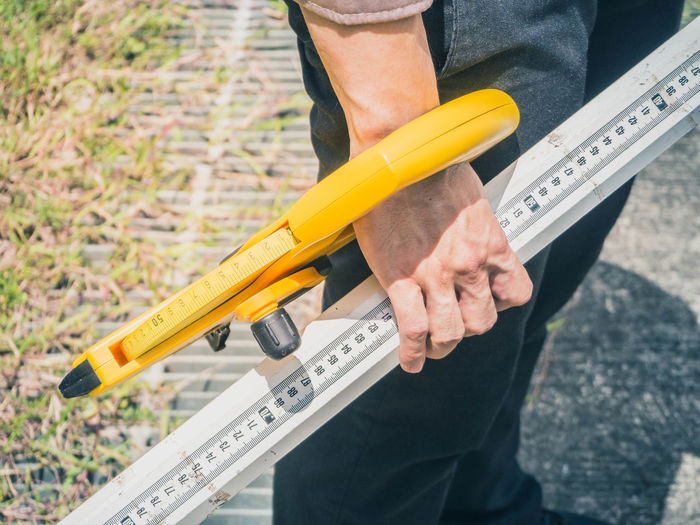 High angle view of man holding work tools