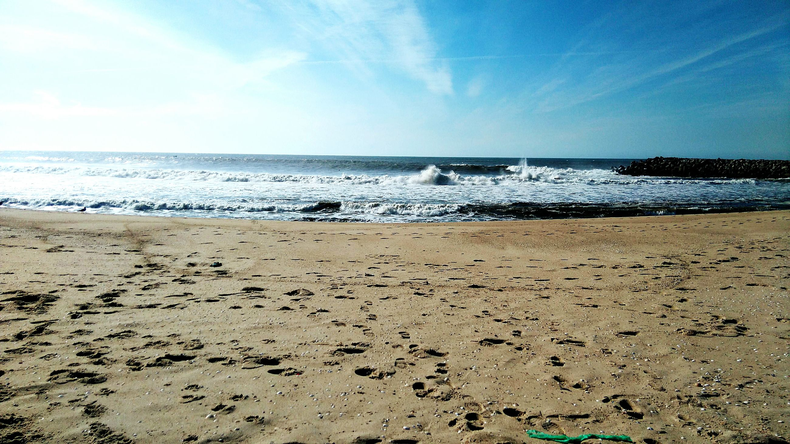 beach, sea, sand, water, shore, sky, horizon over water, tranquility, tranquil scene, scenics, beauty in nature, nature, blue, idyllic, day, coastline, cloud - sky, incidental people, outdoors, cloud