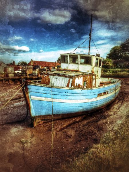 Fishing boat moored at low tide. Brancaster Staithe, Norfolk, England. Brancaster Staithe British England English Fishing Boat Low Tide Maritime Moored Norfolk Old Uk Vessel