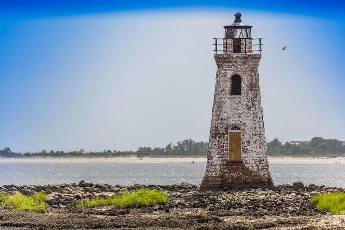 Old Tybee Island Lighthouse Lighthouse Tybee Island GA Architecture Beach Bell Tower Built Structure Day History Lighthouse Nature No People Outdoors Sky Water