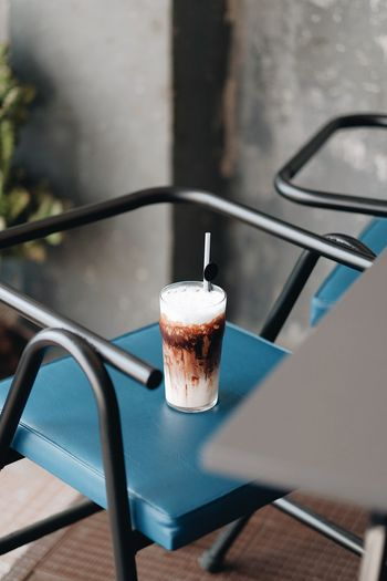 High Angle View Of Chocolate Drink On Chair Outdoors