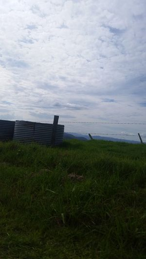 Grass Mountains Mountain Range Mountain Watertank Green Fence Driving Through The Hills Drivebyphotography Drive Landscape Nature Photography [ Afternoon Taking Photos EyeEm Gallery