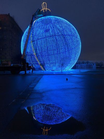 The largest Christmas sphere in Moscow, final strings of lights being attached Blue No People Outdoors Architecture Illuminated Sky Winter Russia Moscow Travel Destinations Night Lights Christmas Lights Built Structure Christmas Decoration Reflection Night Reflections Street Reflections Lights Reflections Round Christmas Decorations Night Illumination Streetphotography Christmas Night Photography Christmas Ornament