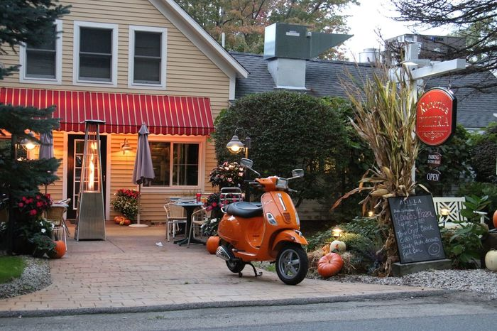 Mode Of Transport Land Vehicle Transportation Motorcycle Bicycle Motor Scooter Building Exterior Stationary Men Travel Full Length Parking On The Move City Roadside Riding Built Structure Architecture Vanishing Point (null) Outdoors Roadside America Pumpkins Pumpkin!Pumpkin!
