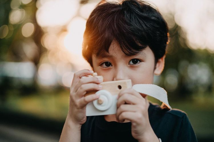 Boys Child Childhood Close-up Cup Drinking Headshot Holding Leisure Activity Lifestyles Looking At Camera Men One Person Outdoors Portrait Teenager