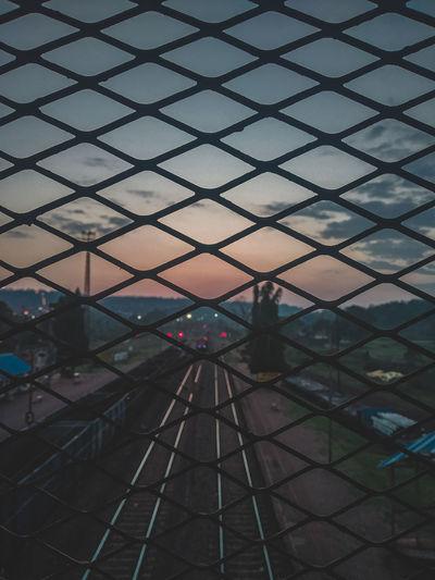 Full frame shot of metal fence against sky