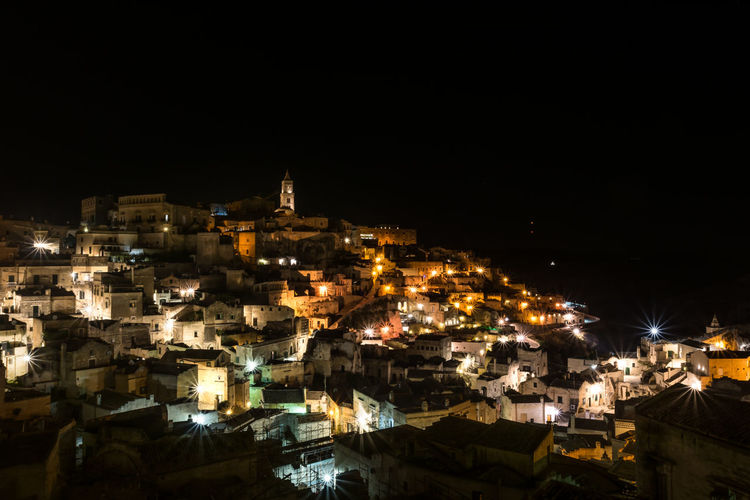View of the old city of Matera, Basilicata, exposure of the center of Matera. Basilicata, Italy  Matera At Night Architecture Basilicata Building Building Exterior Built Structure City Cityscape Clear Sky Community Copy Space Crowded High Angle View Illuminated Matera By Night Nature Night Outdoors Residential District Sasso Settlement Sky Town TOWNSCAPE