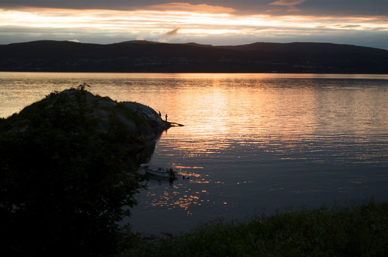 Fishing In Norway Salstraumen Beauty In Nature Cloud - Sky Day Idyllic Lake Mountain Nature Nautical Vessel No People Orange Color Outdoors Reflection Scenics Silhouette Sky Sunset Tranquil Scene Tranquility Tree Water Perspectives On Nature