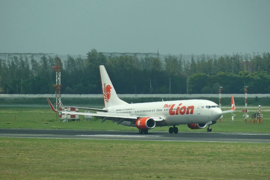 Bangkok, Thailand - April 14,2017 : Thai Lion Air Boeing 737-900ER Touch Down on runway at Don Mueang International Airport on April 14, 2017. Thai Lion Air is a Thai low-cost airline. Air Vehicle Airplane Airplane Background Airport Runway Boeing 737 Boeing 737-900ER Clear Sky Day Don Mueang International Airport Grass International Airport Nature No People Outdoors Runway Runway Airport Sky Thai Lion Air Thailand Touch Down Landing Transportation สนามบิน สนามบินดอนเมือง เครื่องบิน ไทยไลออนแอร์