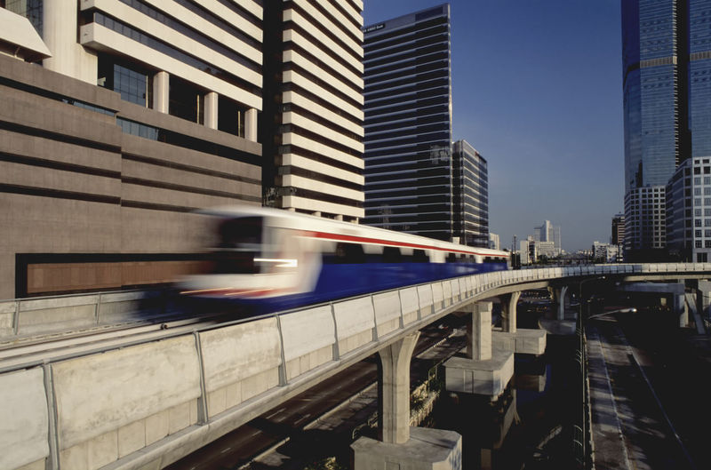 Blurred Image Of Metro Train Moving On Track In City