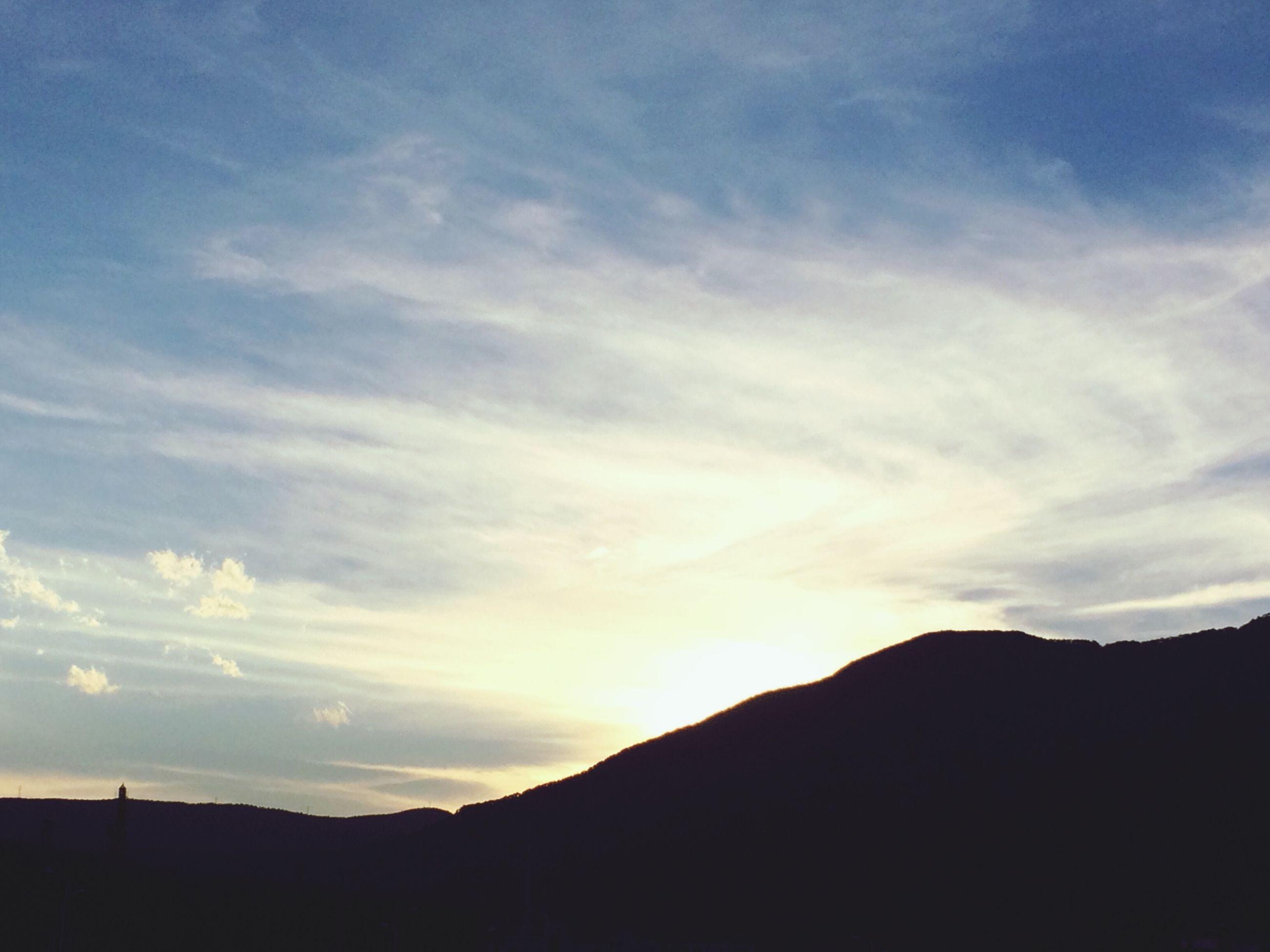 silhouette, tranquil scene, scenics, tranquility, sky, sunset, mountain, beauty in nature, cloud - sky, nature, mountain range, landscape, idyllic, cloud, dusk, non-urban scene, majestic, outdoors, cloudy, dark