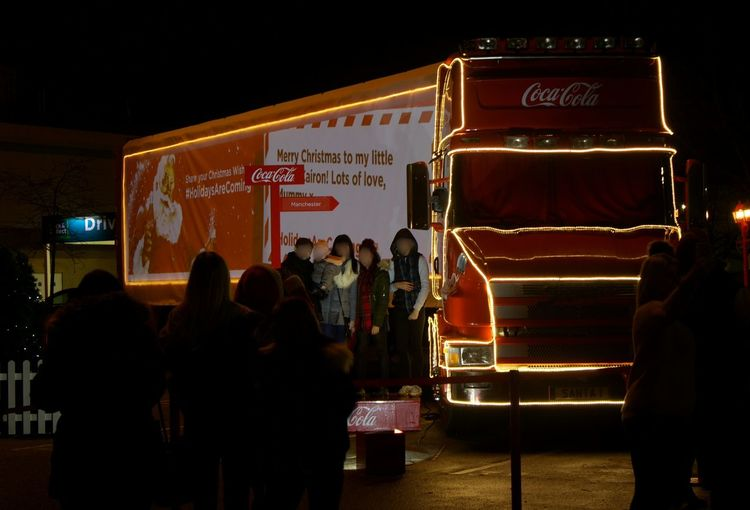 Arts Culture And Entertainment Text People Night Illuminated Adult Adults Only Outdoors Lights In The Dark Lights Red Truck Christmas HolidaysAreComing Holidays Are Coming Holidays Are Coming! Coca Cola Truck Coca Cola Coca-cola Manchester