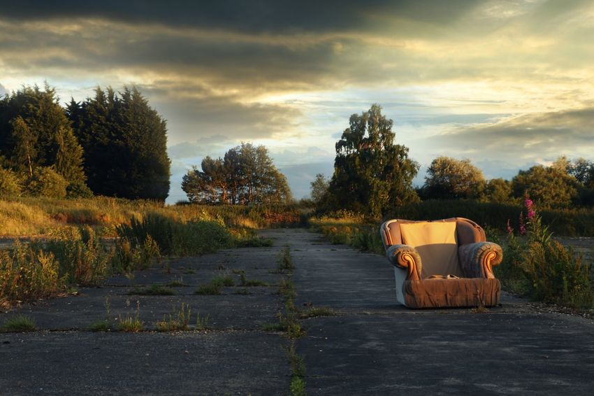 Bleak looking scene of an abandoned chair on a derelict farm site Outdoors Ruins Abandoned Places No People Cloud - Sky Mushroom Farm Golden Hour Chair Broken Chair Sunset