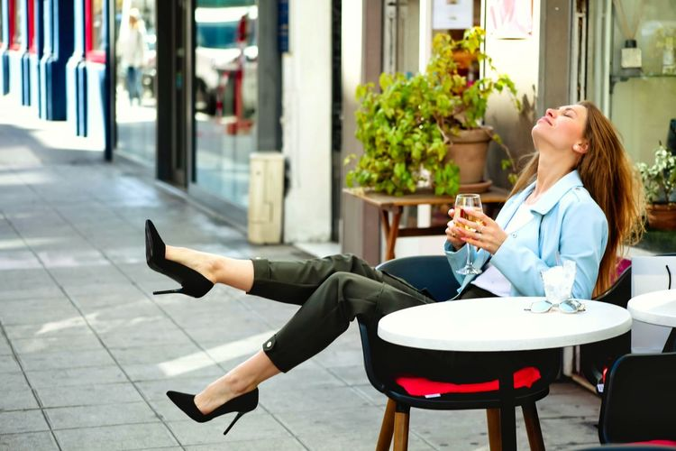 Woman sitting on chair at cafe