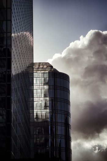 Billowing clouds over Brussels downtown area Building Exterior Cloud - Sky Architecture Office Building Exterior Skyscraper Sky Clouds Cumulus Building Glass Facades