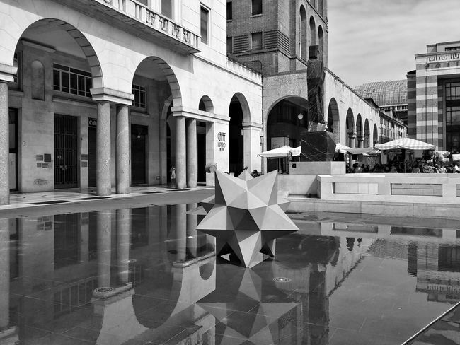 Questionable architecture but still a pleasant view and a natural mirror effect Mimmo Paladino Ouverture Architecture Building Exterior City Urban Geometry Urban Perspectives Urban Photography Blackandwhite Black And White B&w Photography EyeEm Explorer Urbanspace My City Cityscape Mobile Photography Mirror Effect Water Surface Reflection The Week On EyeEm