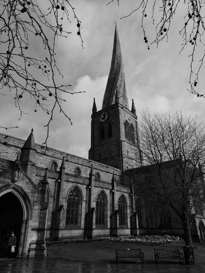 Crooked Spires. Streetphoto_bw Huaweiphotography Huawei P20 Pro Photography Alucyart Huawei Photography Malephotographerofthemonth Church Crooked Spire City Place Of Worship History Religion Business Finance And Industry Architecture Built Structure Building Exterior Ancient Clock Tower Tower