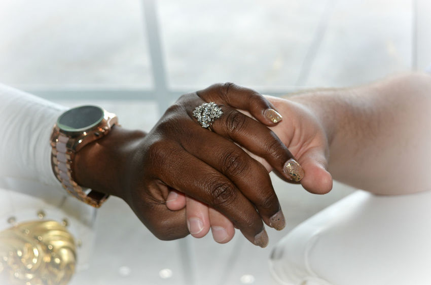 Close-up Focus On Foreground Holding Human Body Part Human Hand Life Events Multi Cultural Multi Racial People Real People Ring Two People Watch A New Beginning