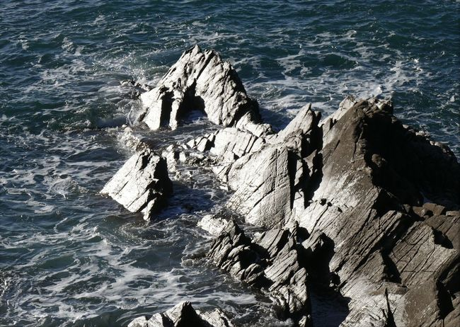 Cliff Eroded Geology Physical Geography Power In Nature Rock Formation Rocky Sea Stone Tranquil Scene Voyage Water