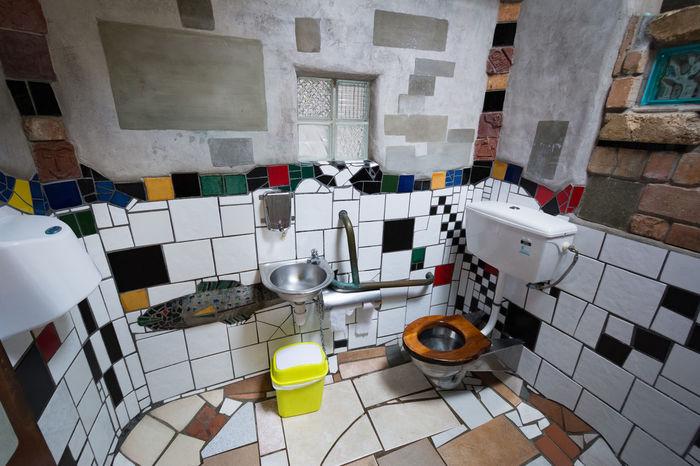 Kawakawa (New Zealand) Public Toilets project by Austrian artist Hundertwasser. Art Artist ArtWork Austrian Artist Day Hundertwasser Kawakawa Neuseeland New Zealand No People Public Toilet Tile Tiled Floor