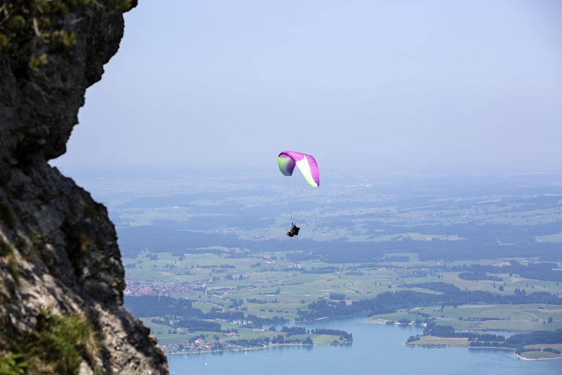 Adventure Bavarian Alps Beauty In Nature Challenge Day Extreme Sports Flying Forggensee Landscape Leisure Activity Lifestyles Mountain Nature Outdoors Parachute Paragliding Paragliding Paragliding Fun Paragliding Over Water People Sea Sky Sport Tegelberg