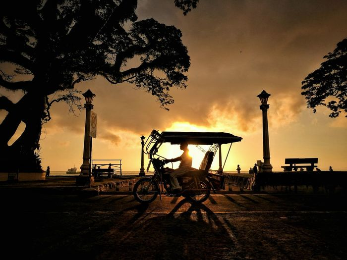 DumagueteCity Philippines The Traveler - 2018 EyeEm Awards Mode Of Transportation Orange Color Outdoors Silhouette Sunlight Sunrise Transportation Tricycle