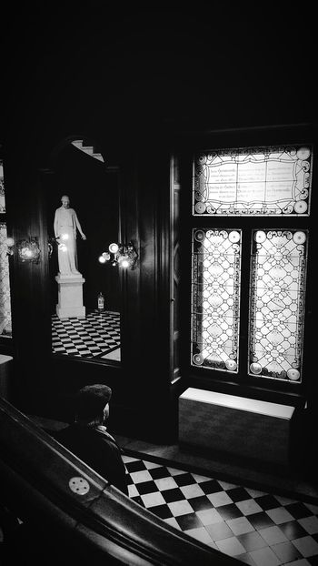 Window Illuminated Indoors  Painted Glass Window Statue Man Solitary Lights Black And White Tiles Standing One Person Day