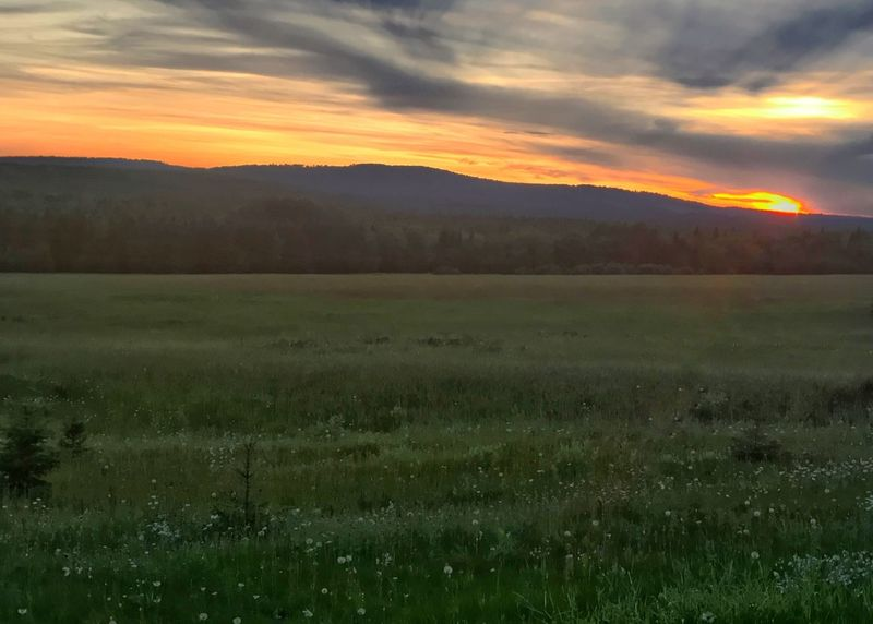 Sunset over meadow and hills. Meadow Sunset Scenics Field Grass Landscape Mountain Hill Horizon Over Land Rural Scene Horizontal Tranquil Scene