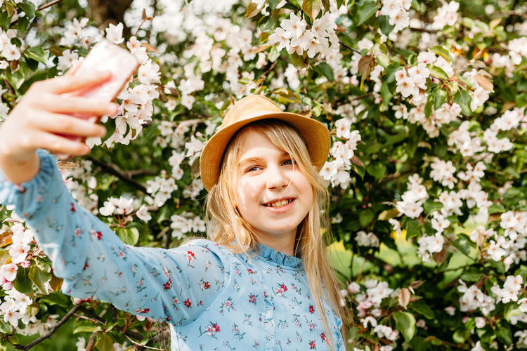 Portrait of smiling girl with flowers