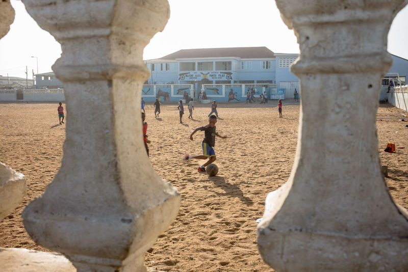 Africa Collection: West Africa, Ghana, Accra the Capital, Jamestown area, children playing their favourite sport soccer in front of the house of the area's chief Accra Active Africa Ball Built Structure Chief Dynamic Football Ghana House Outdoors Perspective Run Soccer Sport Tourism Travel Destinations West Africa Youth The Photojournalist - 2016 EyeEm Awards Street Photographer-2016 Eyem Awards Great Outdoors - 2016 EyeEm Awards Original Experiences Natural Light Portrait