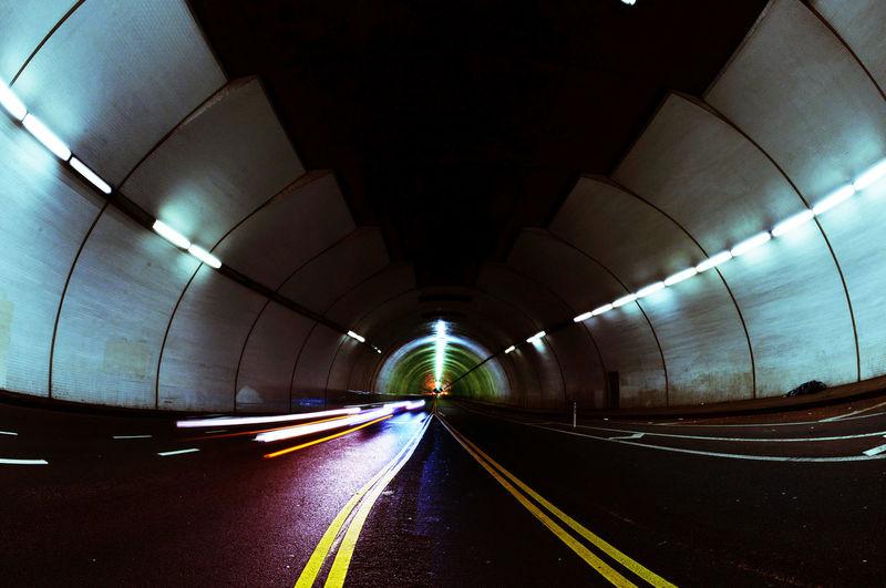 Light trails in illuminated tunnel
