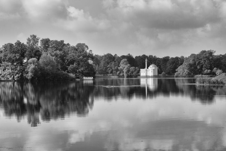 pavilion and trees reflected in a lake Beauty In Nature Black And White Building Clouds Countryside Day Lake Landscape Nature No People Outdoors Palace Pavilion Reflection Russia Sky St. Peteresbur The Great Outdoors - 2017 EyeEm Awards Tree Water Waterfront