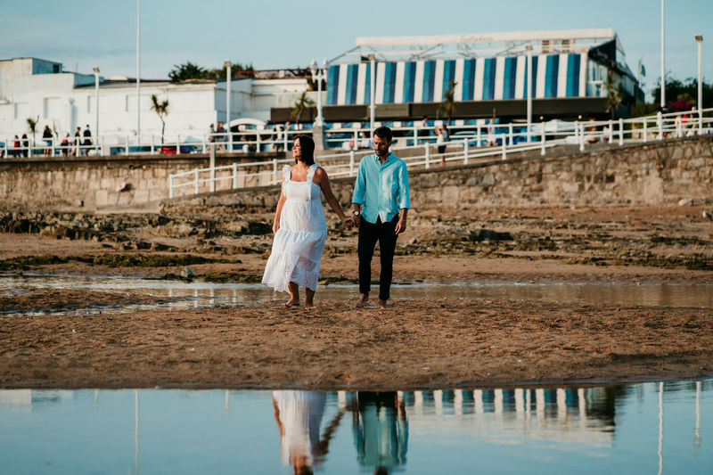 Rear view of couple walking on water