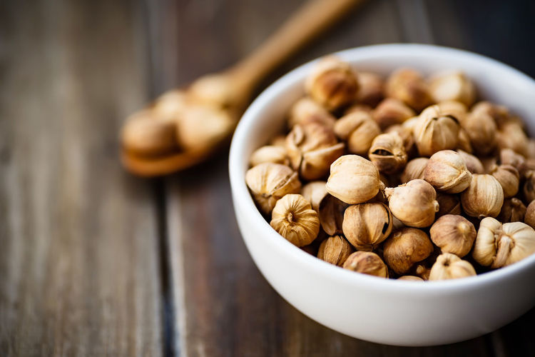 Thai Cardamom Food And Drink Food Still Life Bowl Table Wellbeing Freshness Close-up Large Group Of Objects Healthy Eating Wood - Material Indoors  No People Selective Focus Nut Focus On Foreground Nut - Food High Angle View Brown Heap Snack Cardamom