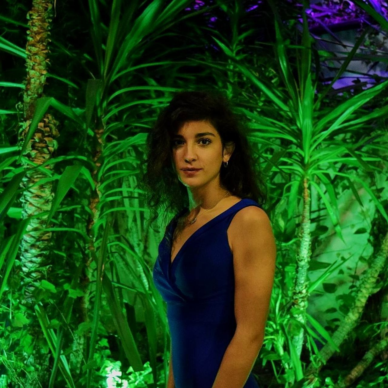 green color, young adult, standing, one person, looking at camera, portrait, plant, beautiful woman, real people, young women, growth, lifestyles, leaf, outdoors, nature, night, tree, people