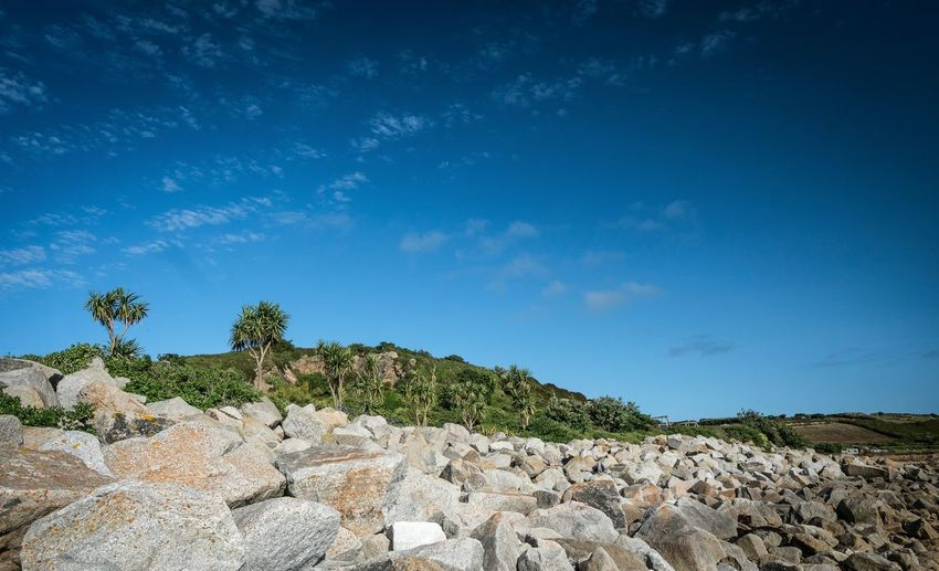 Scenic view of rocky landscape against blue sky