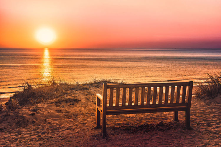 Bench Beach Beauty In Nature Horizon Horizon Over Water Idyllic Land Nature No People Orange Color Outdoors Sand Scenics - Nature Sea Sky Sun Sunset Sylt Tranquil Scene Tranquility Water Wood - Material