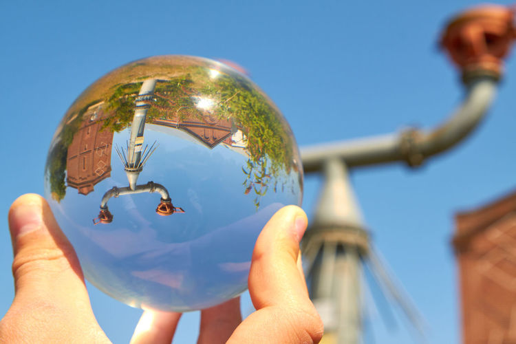 Protego cap Protego Protego Cap Architecture Blue Body Part Building Exterior Built Structure Close-up Day Finger Focus On Foreground Glass Glass Sphere Hand Holding Human Body Part Human Hand Nature One Person Outdoors Real People Responsibility Sky Sphere Sunlight
