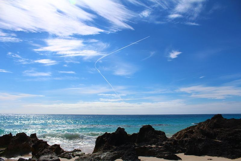 Quick Bank Bermuda Airplane Vapor Trail Quick Turn Sea Sky Scenics Horizon Over Water Beauty In Nature Nature Rock - Object Water No People Tranquility Outdoors Tranquil Scene Cloud - Sky Beach Day