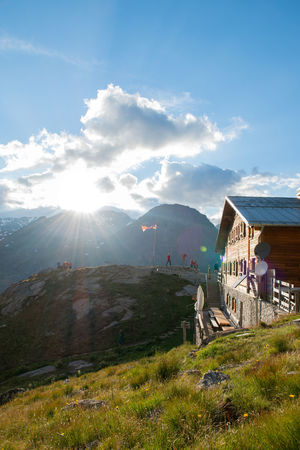 Sunset in the alps View Alps Mountain Home With A View Sunset Hütte Sunlight Lens Flare Sunbeam Sky Building Exterior Architecture Residential Structure Sun Sunset Evening Idyllic