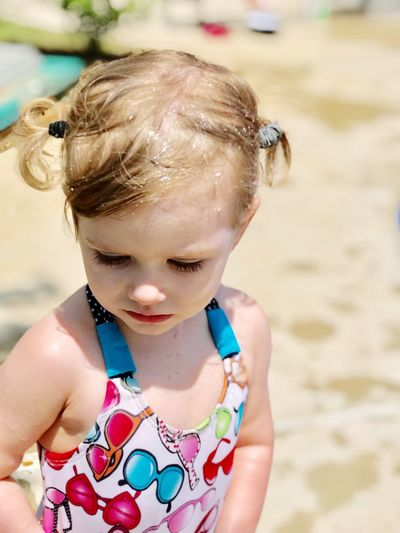 Toddler at the Pool Pigtails  Summer Swimming Pool Girl EyeEm Selects Child Childhood One Person Girls Beach Real People Outdoors Cute Innocence Water Leisure Activity Day
