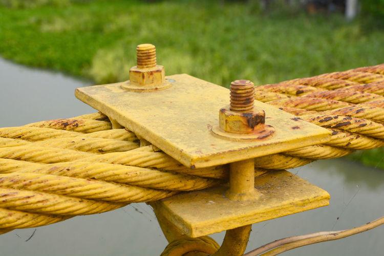 Close-up of rusty metallic equipment outdoors