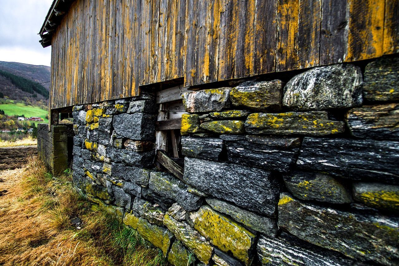 OLD STONE WALL BY BUILDING