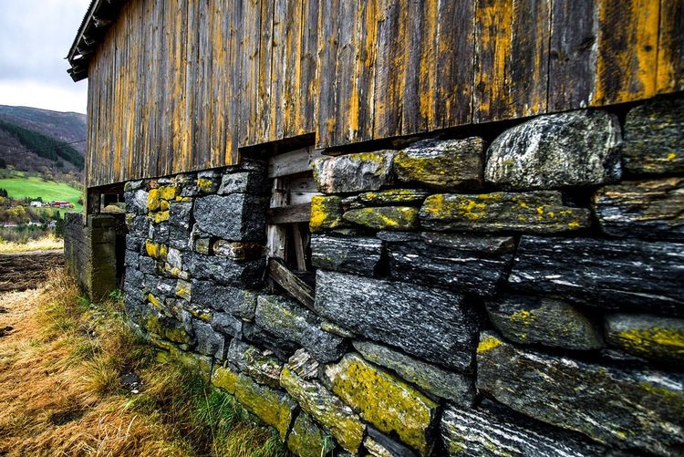 Old weathered wall by building
