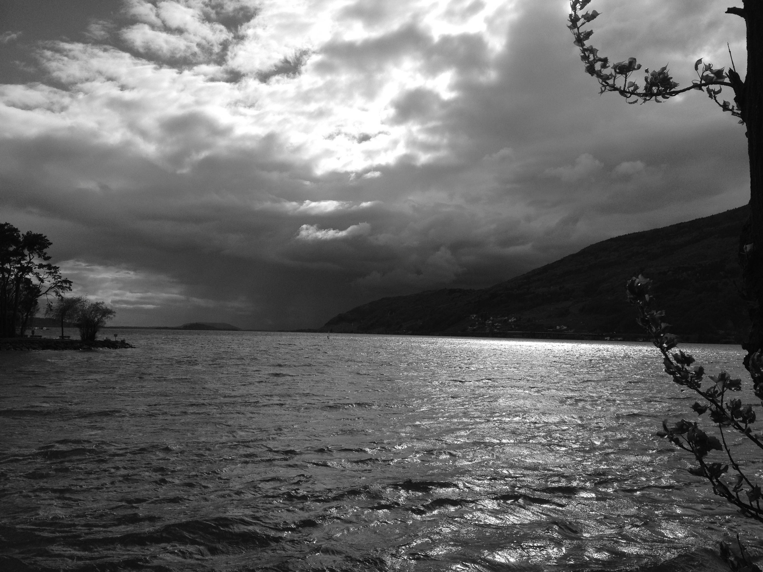 cloud - sky, sky, water, beauty in nature, sea, scenics - nature, tranquility, tranquil scene, nature, waterfront, no people, mountain, outdoors, day, horizon, environment, overcast, storm, ominous