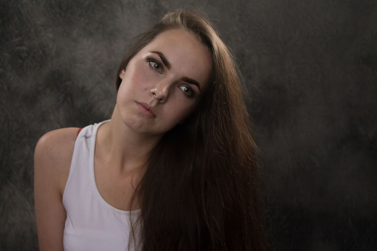 Adult Beautiful Woman Beauty Black Background Brown Hair Casual Clothing Contemplation Front View Hair Hairstyle Headshot Indoors  Long Hair Looking At Camera One Person Portrait Teenager Women Young Adult Young Women