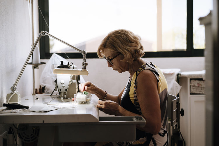 Side view of woman working on table